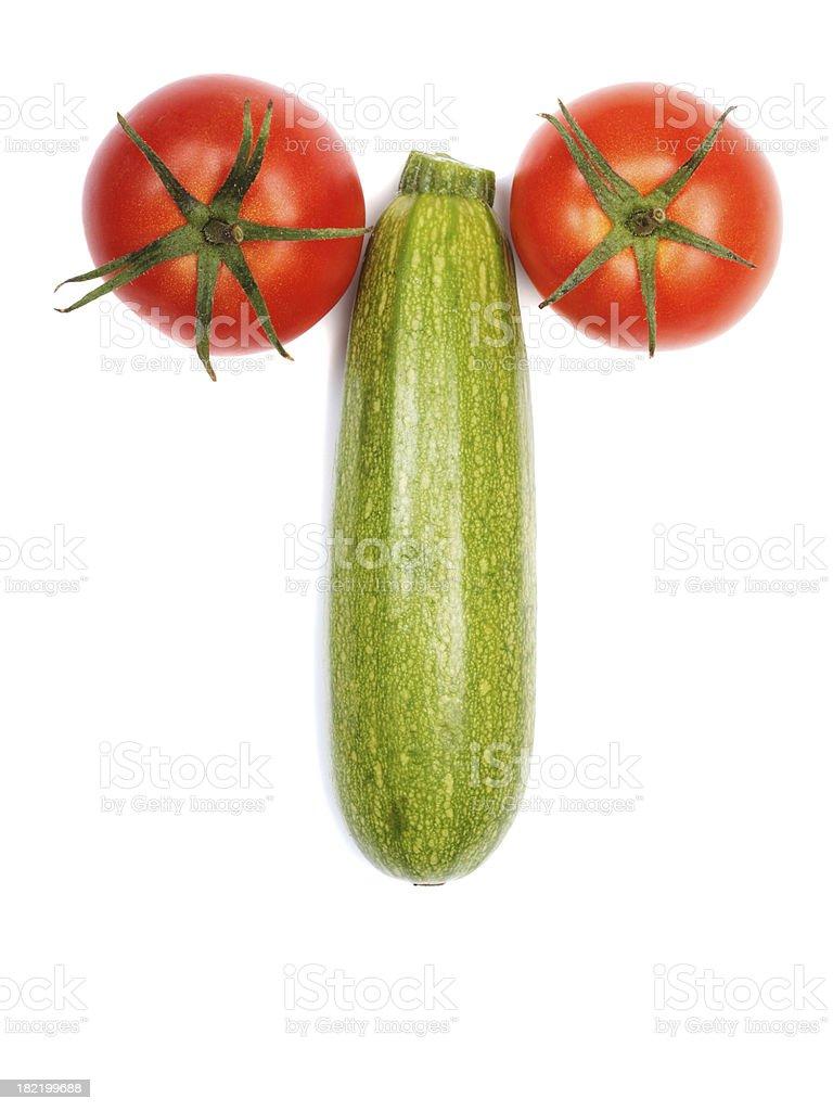 Two Tomatos And A Zuchini stock photo