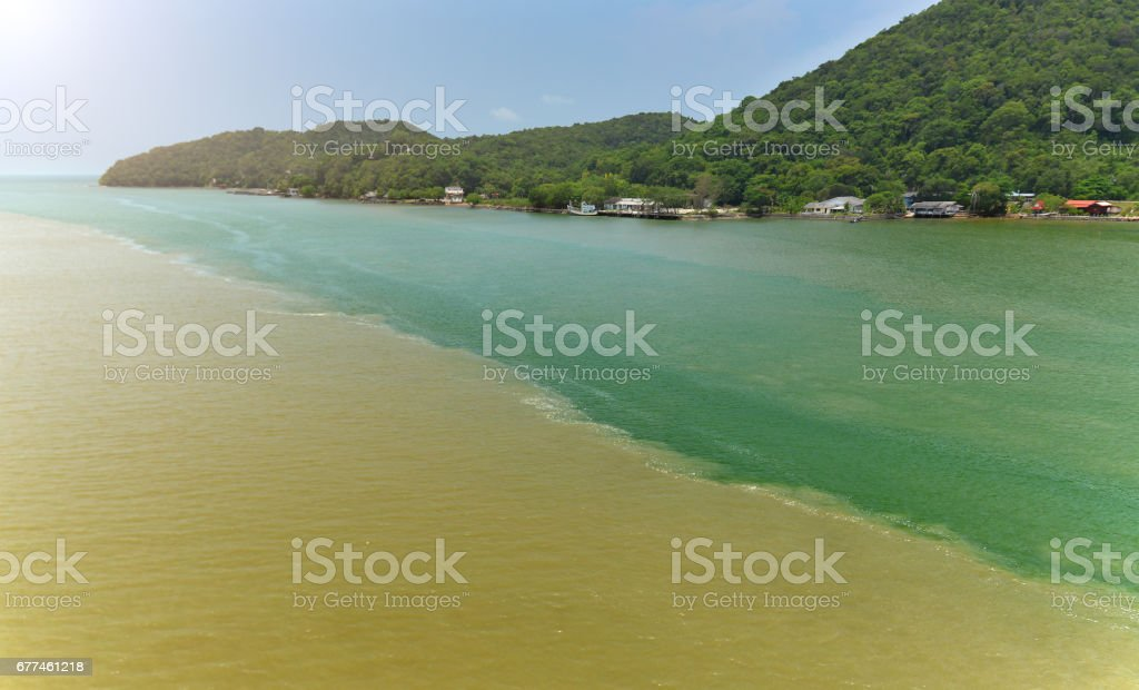 Two tone color of water at the eatuary. stock photo