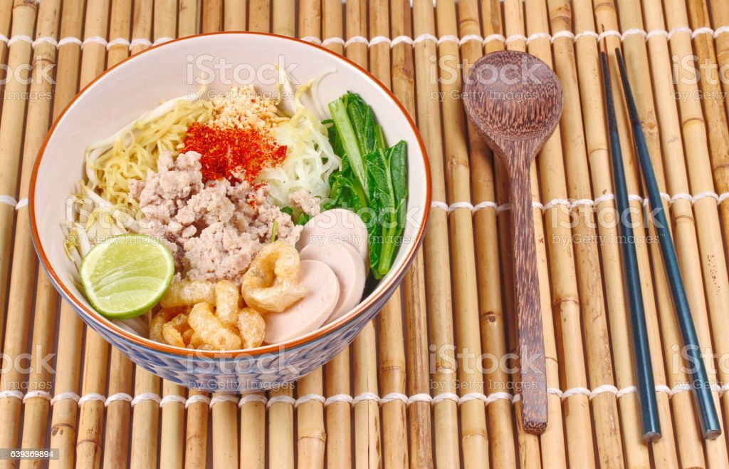 Two tone noodle ,white and yellow, with tom yum. stock photo