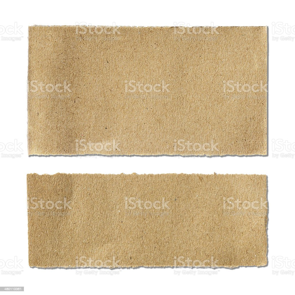 two torn brown paper sheet on white background stock photo