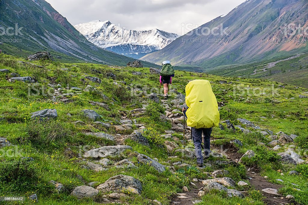 Two tourists going on the trail in tunka range stock photo