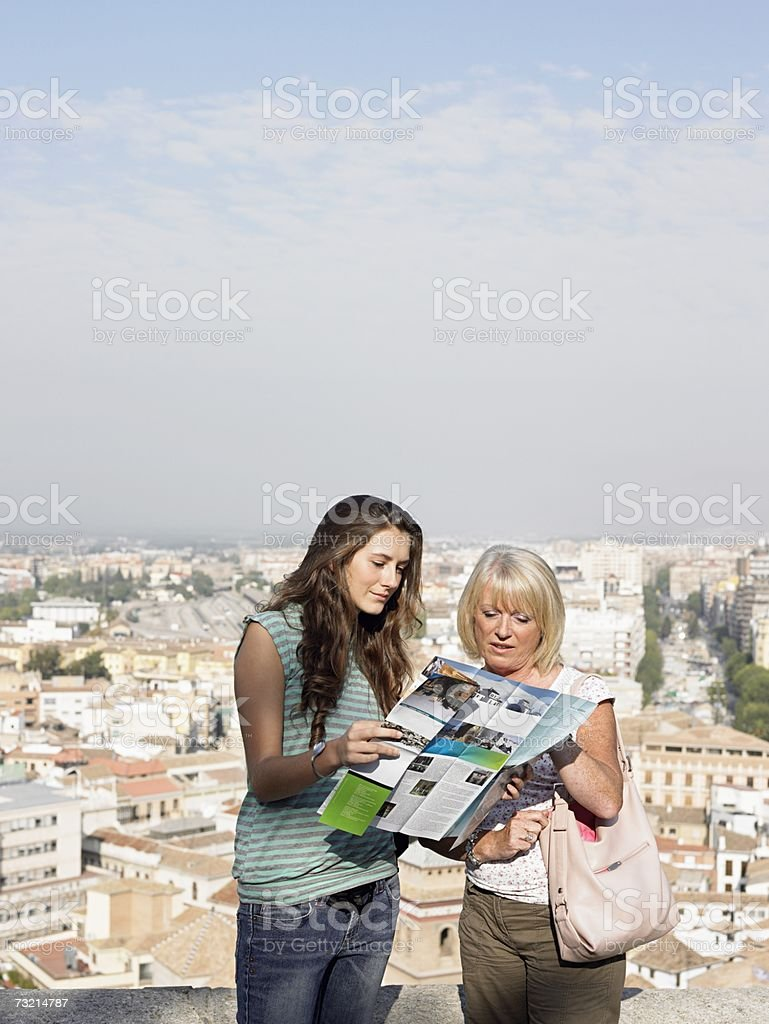 Two tourists looking at a map stock photo