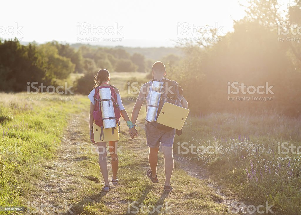 Two tourists make hiking royalty-free stock photo