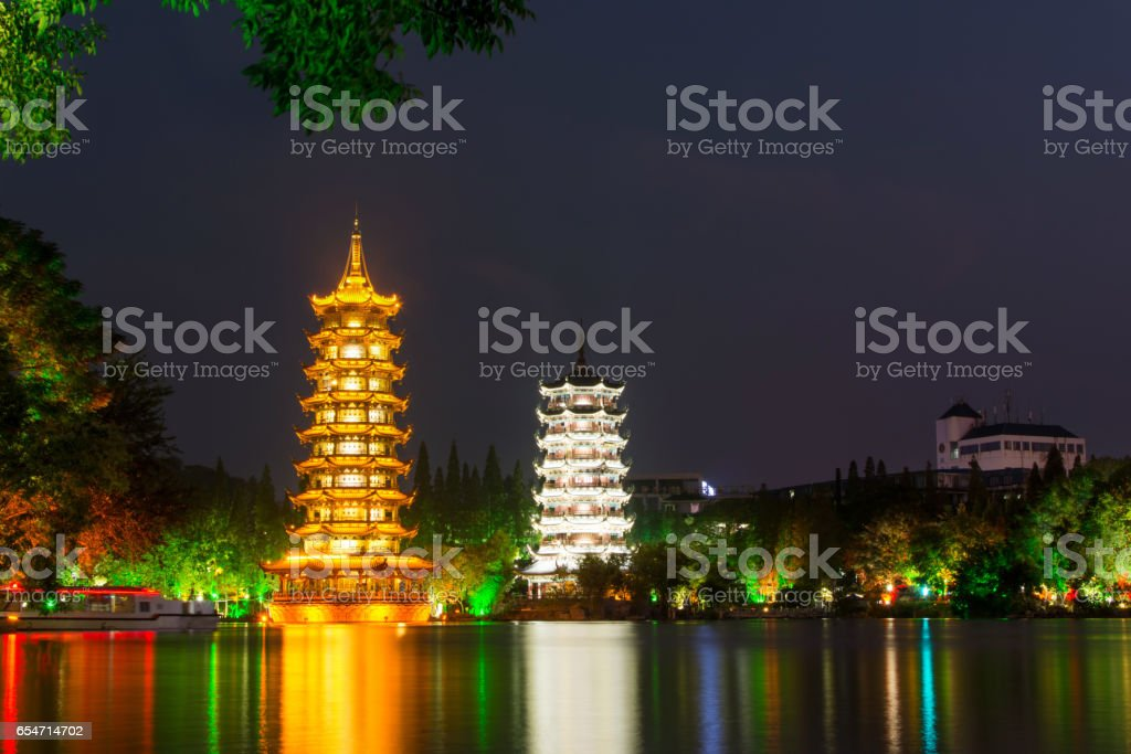 Two towers in Guilin China at night stock photo