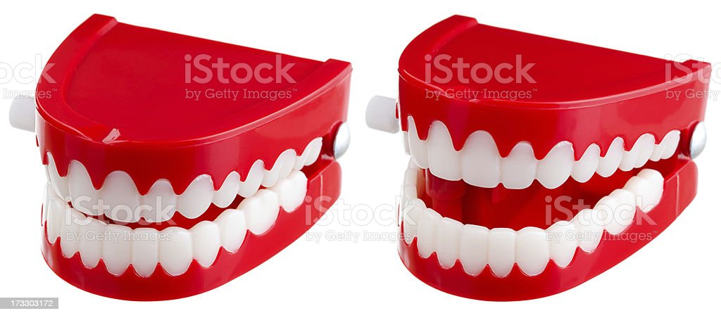 Two toy wind-up chatter teeth on a white background stock photo