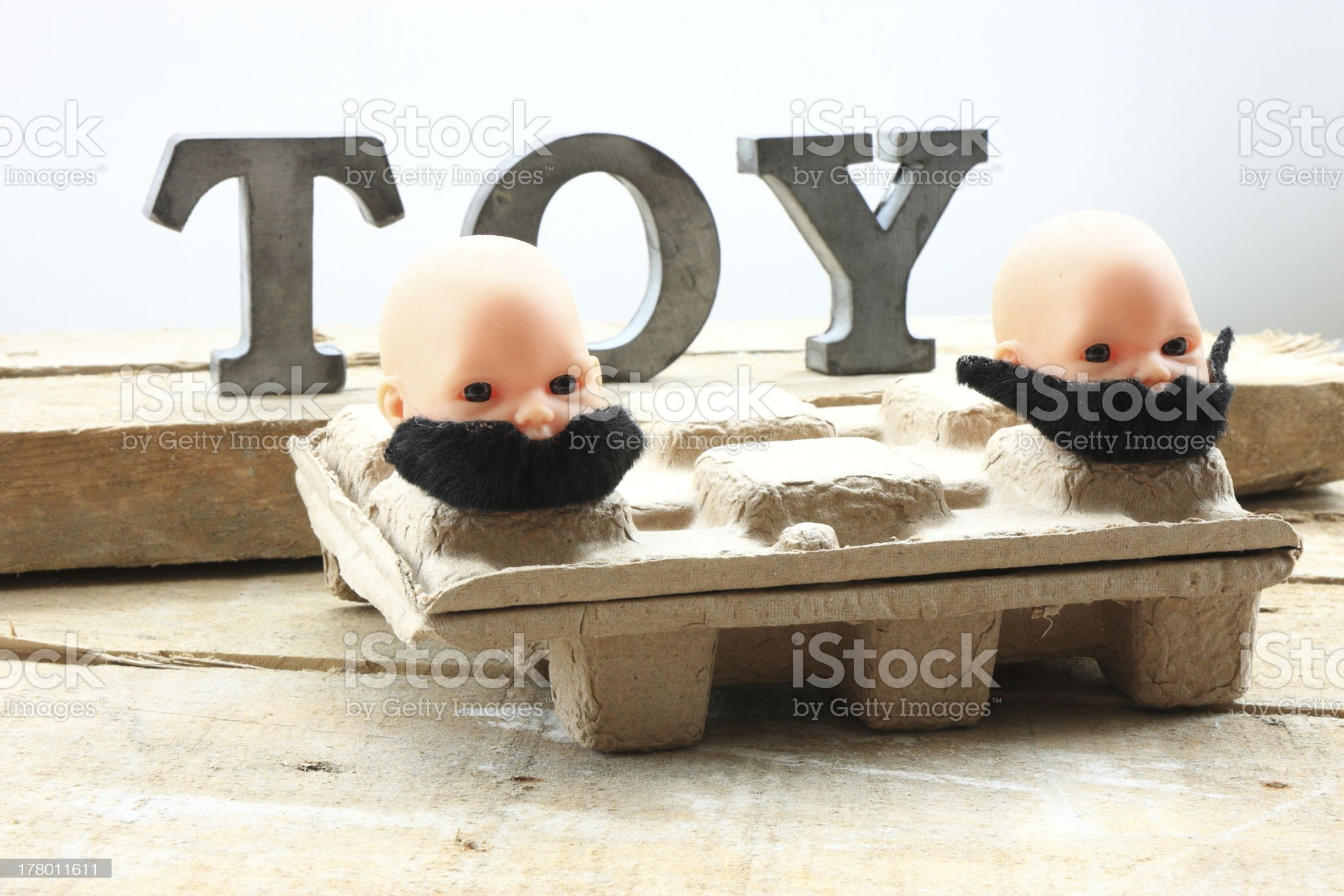 Two toys with moustaches royalty-free stock photo