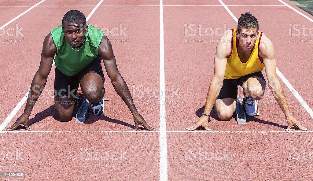 Two Track and Field Athletes Ready to Start the Race royalty-free stock photo