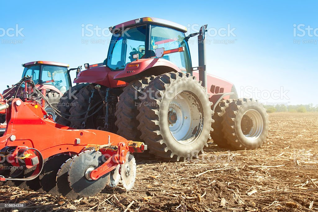 Two tractors in a field stock photo