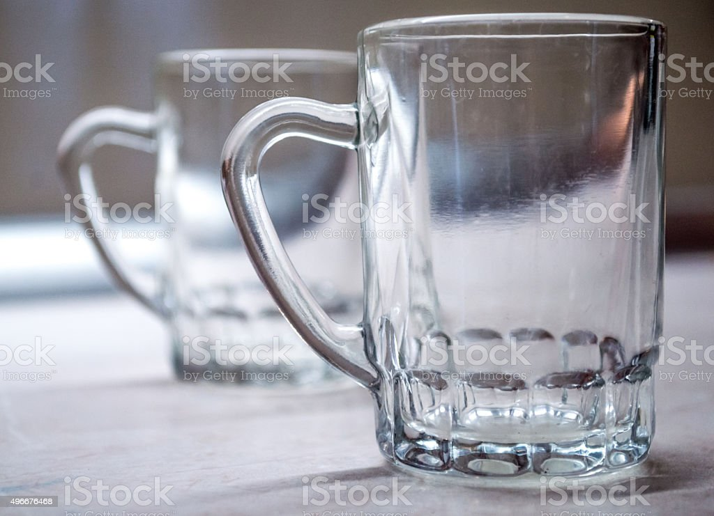 Two Traditional Beer Glasses in a Row royalty-free stock photo