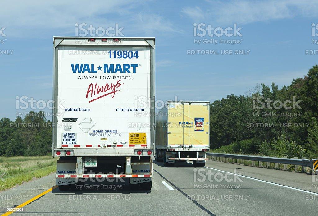 Two Trailer Trucks on interstate highway stock photo