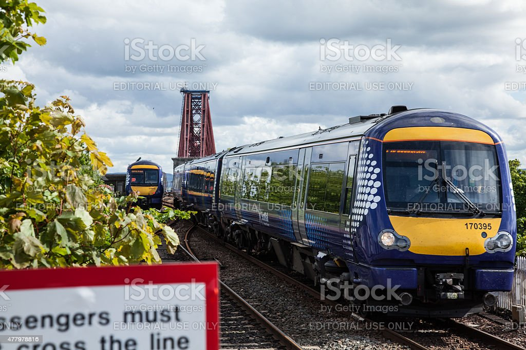 Two trains pass eachother at North Queensferry stock photo