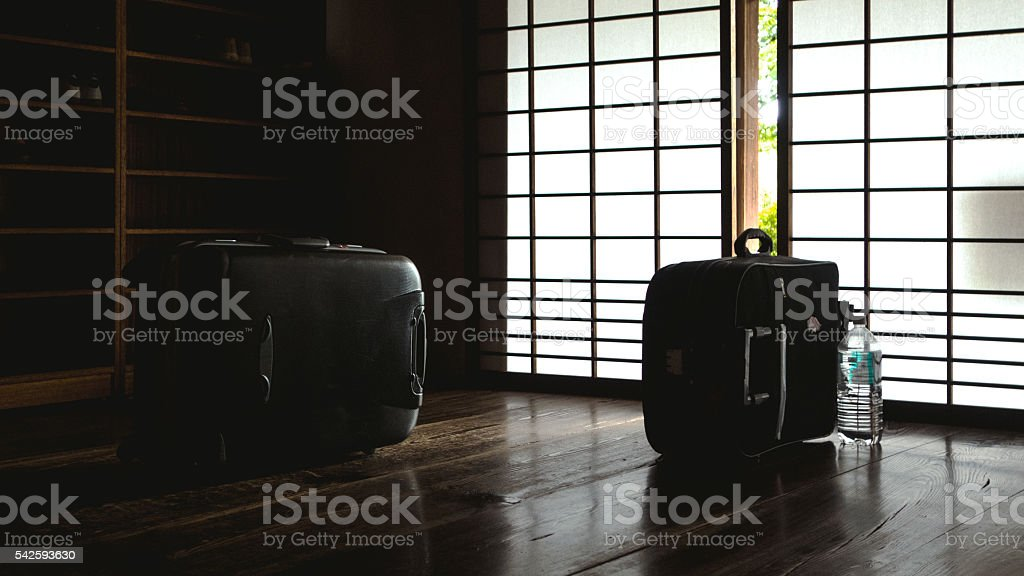 Two travel luggages on the entrance of Japanese Ryokan stock photo