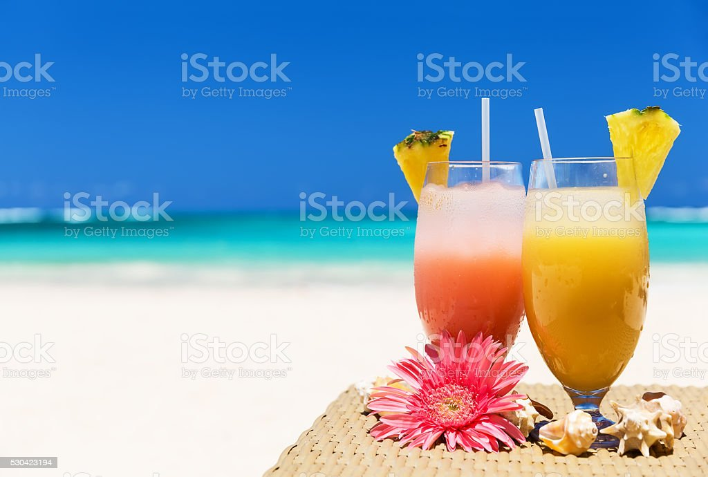 Two tropical fresh juices on the beach stock photo