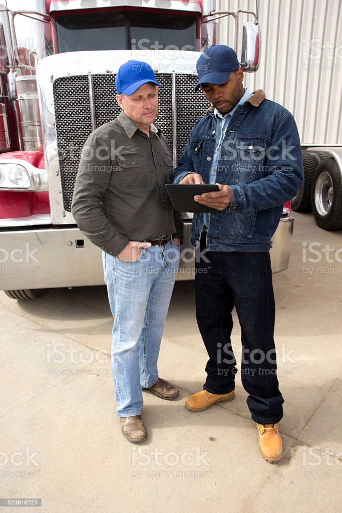 Two Truck Drivers using a Computer stock photo