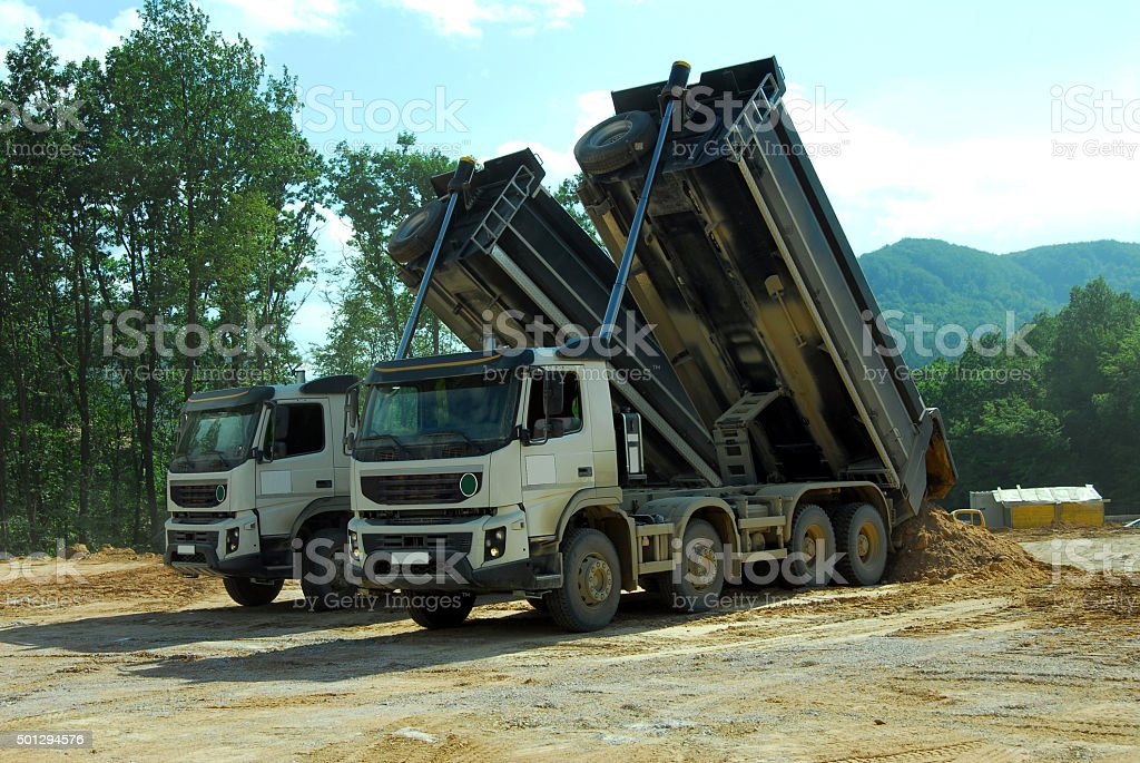 two truck tipper at work stock photo