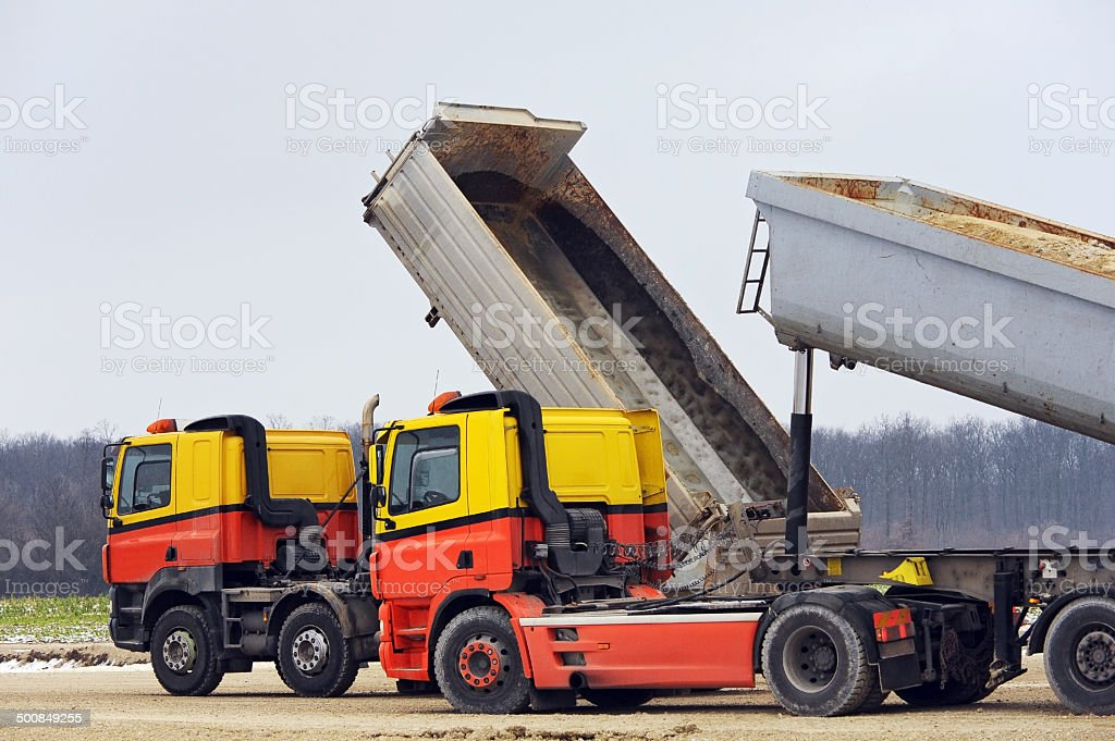 Two trucks on the site stock photo
