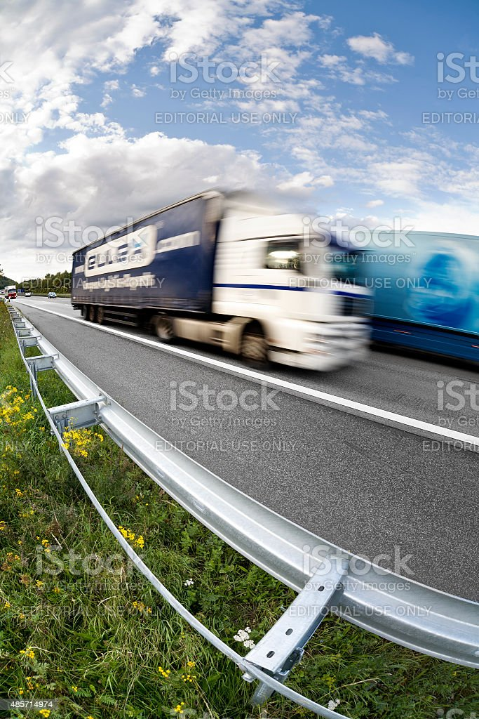Two trucks passing by on german Autobahn A3 stock photo