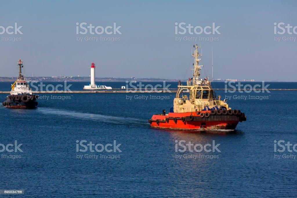Two tugboats ship on maneuvers. stock photo