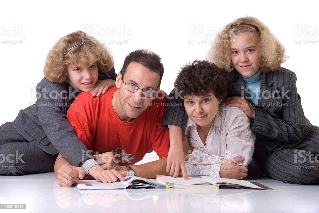 Two twins with parents royalty-free stock photo