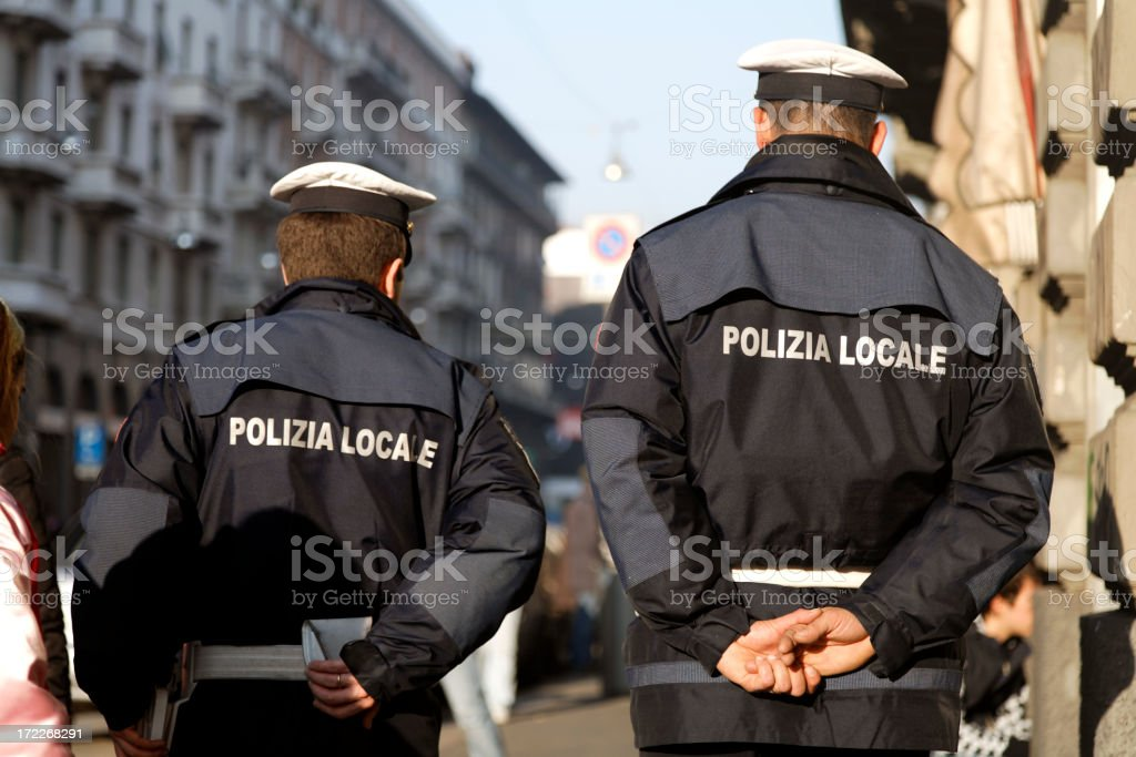 Two typical Italian Policemen on Patrol in Street. royalty-free stock photo
