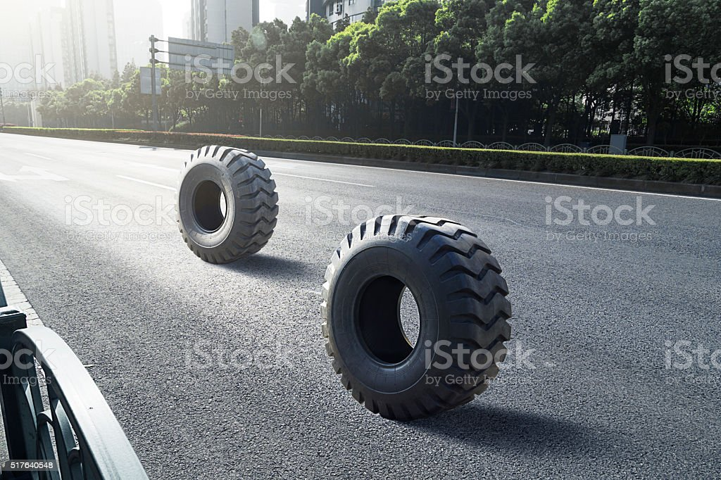 Two tyres on the road stock photo