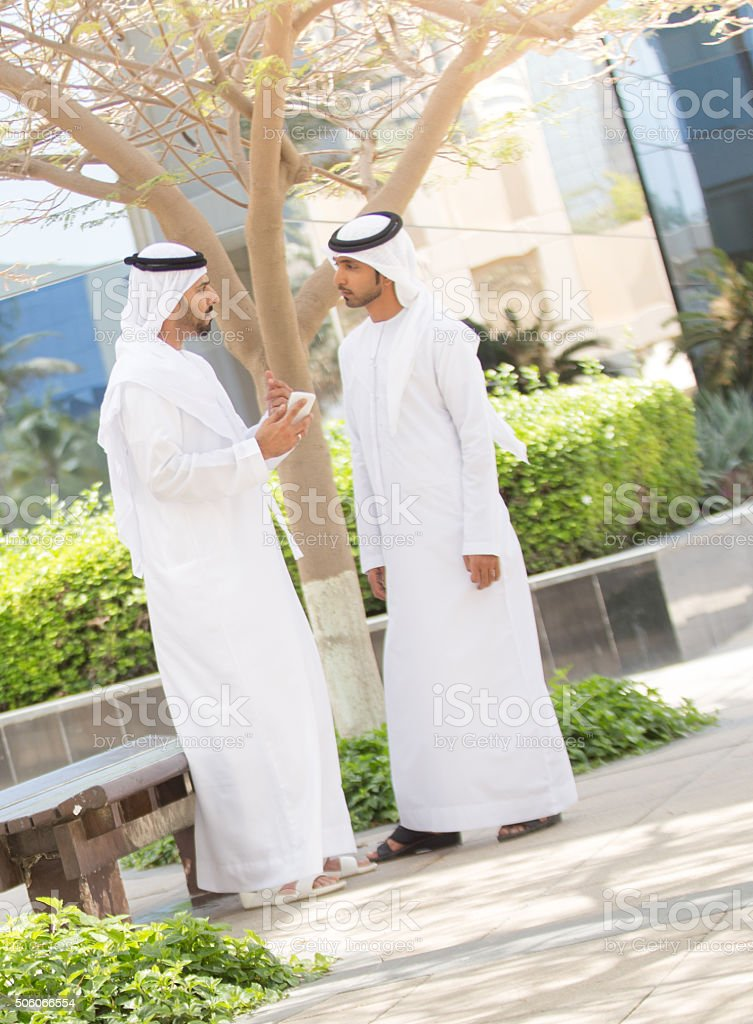 Two UAE Nationals in conversation stock photo