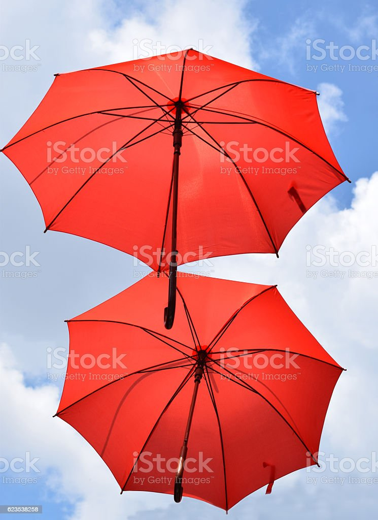 Two umbrellas flying in the wind stock photo