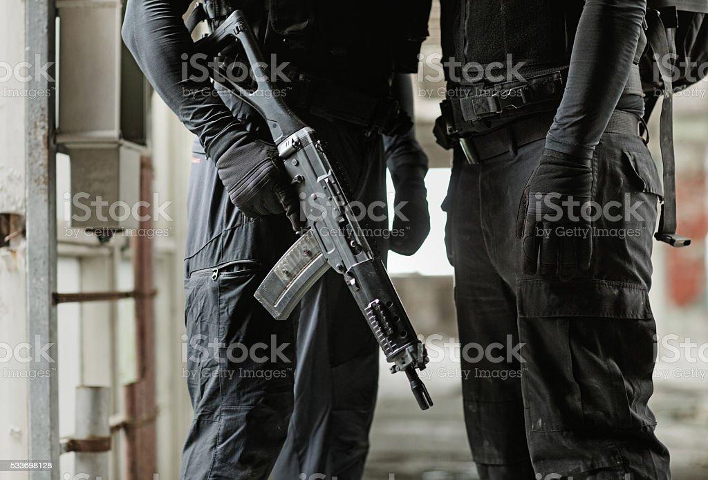 Two unknown swat team members posing in urban setting stock photo