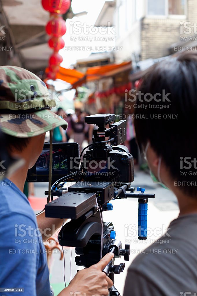 Two unreconizable videographer using a Canon 5D Mark II royalty-free stock photo