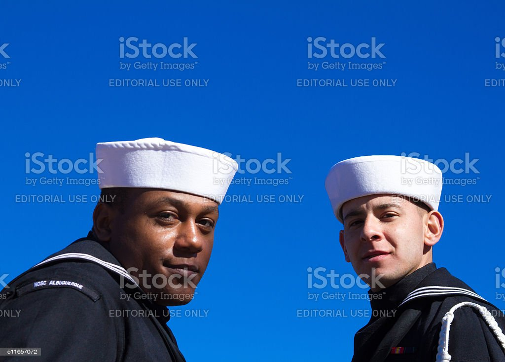 Two US Sailors at Veterans' Day Memorial Service, Blue Background stock photo