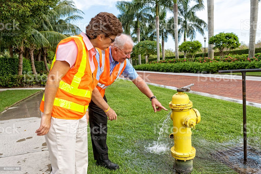 Two Utility County Supervisors Check Out a Water Hydrant stock photo