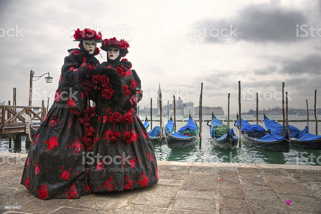 Two venetian masks in San marco's square. Venice Italy.. royalty-free stock photo