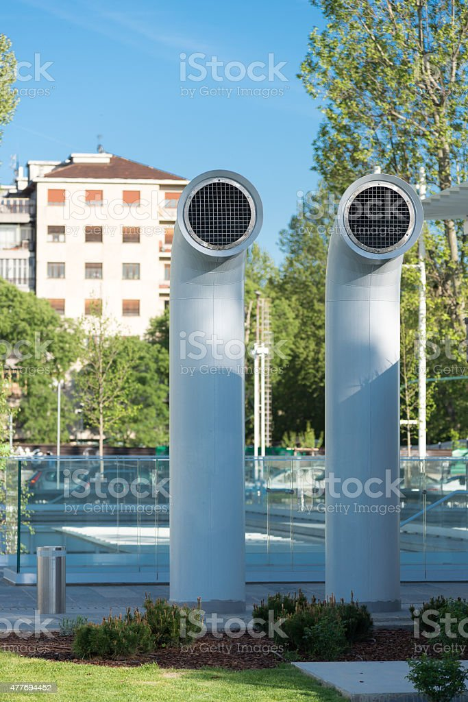 Two ventilation chimneys painted steel stock photo