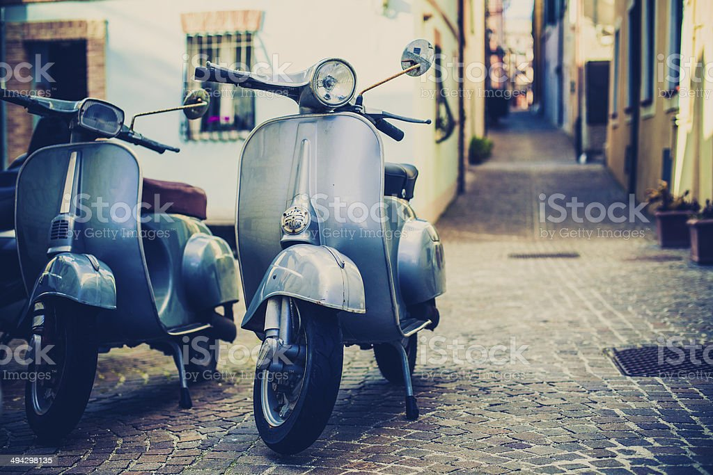 Two Vespa Scooter in Italy stock photo