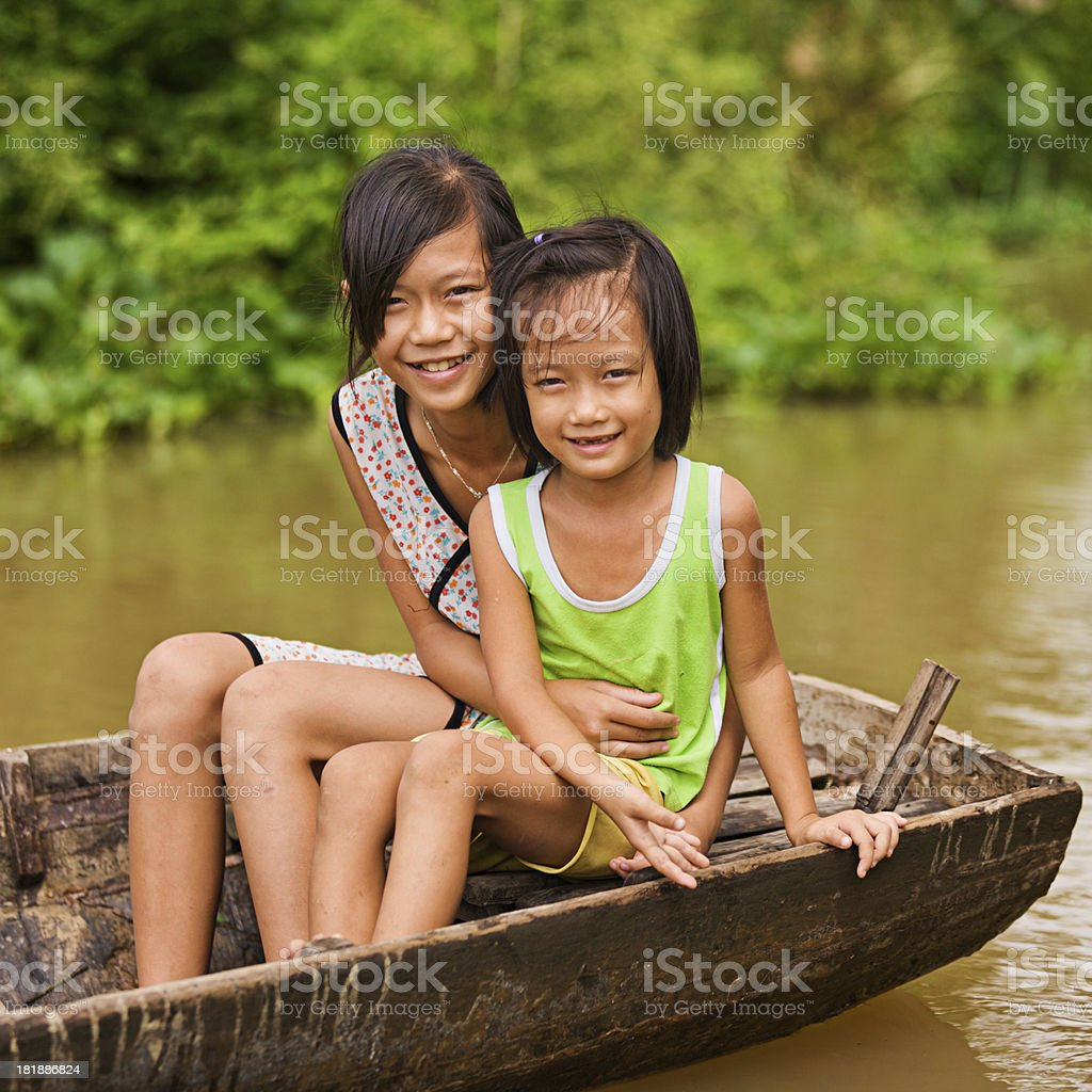 Two Vietnamese girls on boat in Mekong River Delta, Vietnam royalty-free stock photo