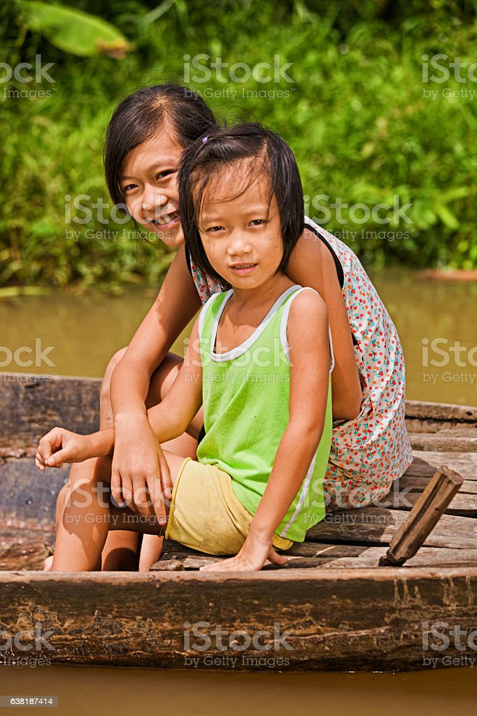 Two Vietnamese girls on boat in Mekong River Delta, Vietnam stock photo