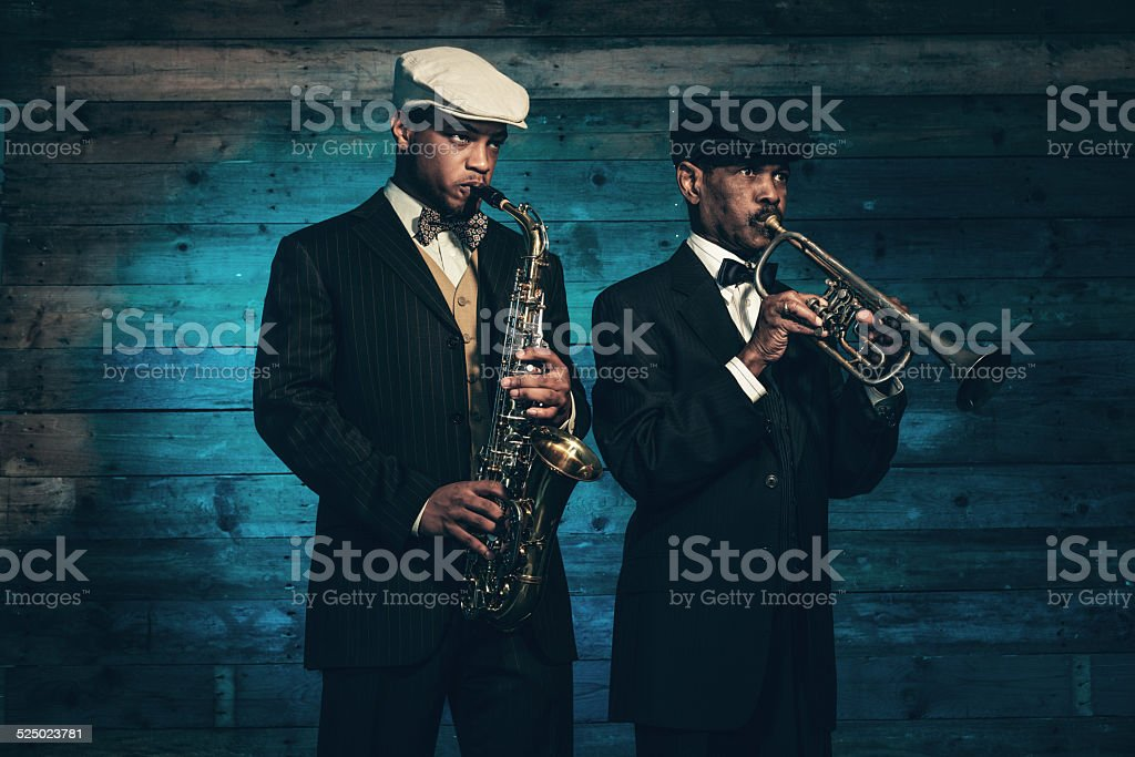 Two vintage african american jazz musicians with trumpet and saxophone. stock photo