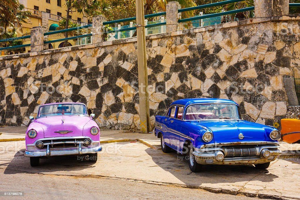 Two vintage cuban cars stock photo