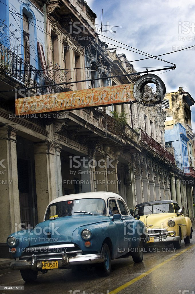 Two vintage Cuban taxi cars stock photo