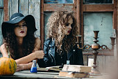Two vintage witch sitting at the table