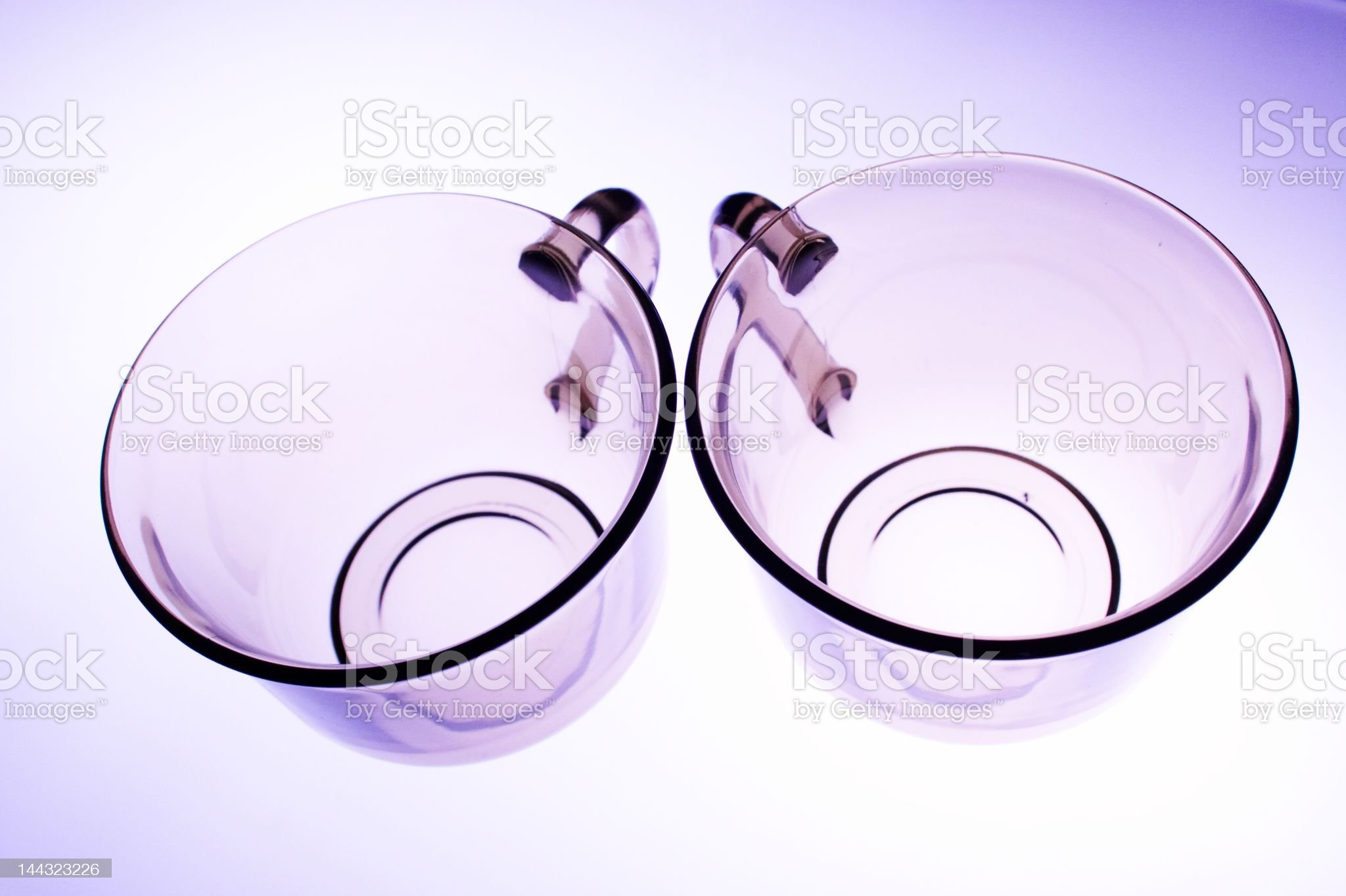 Two violet transparent cups royalty-free stock photo