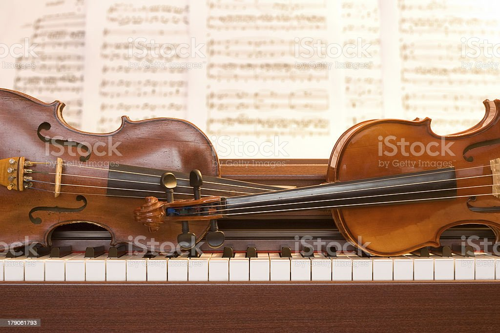 Two violins on piano keys royalty-free stock photo