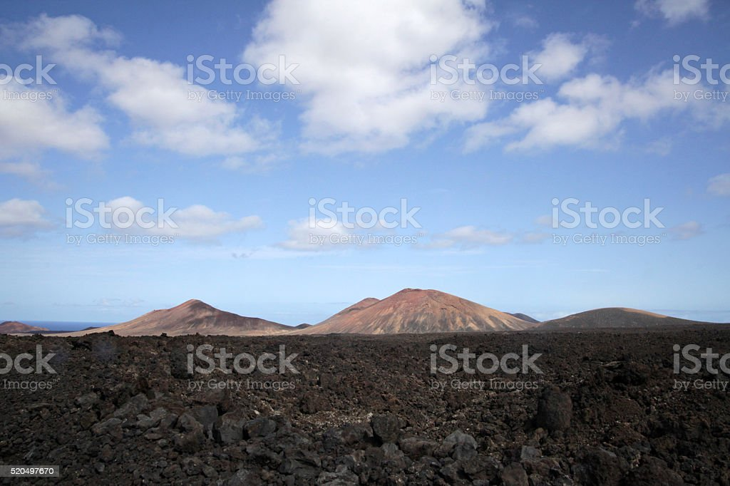 Two volcanos in summer landscape stock photo