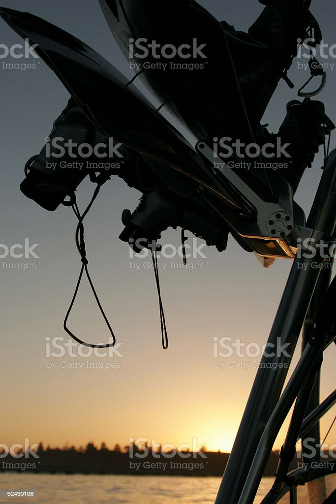 Two wakeboards on racks at sunset royalty-free stock photo