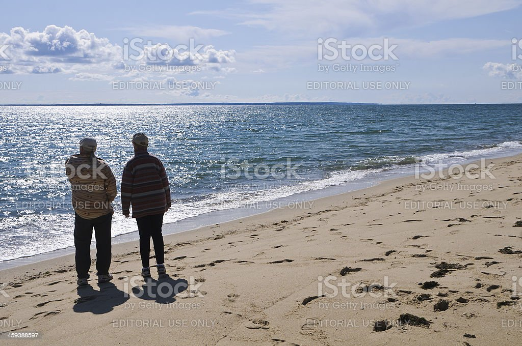 Two Walkers on the Beach stock photo