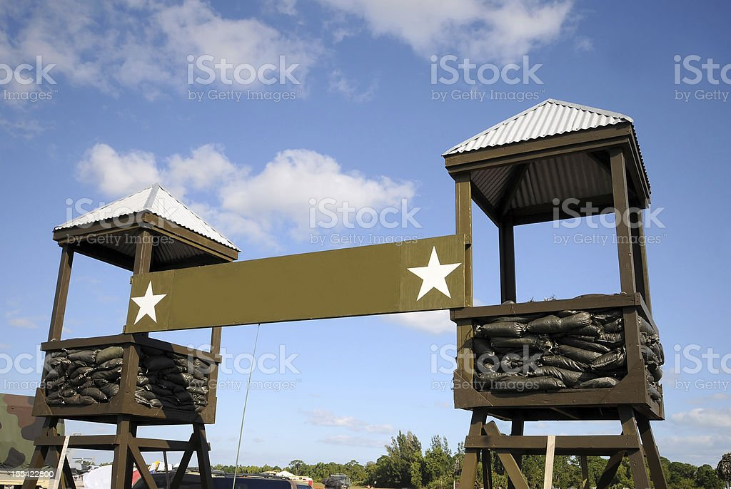 Two watchtowers at a military camp stock photo