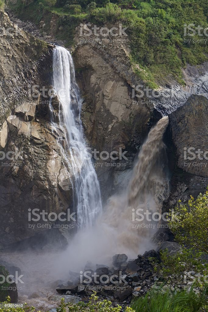 Two waterfalls merge together stock photo