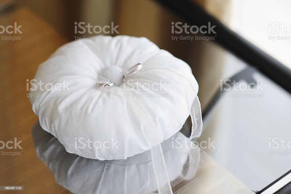 Two wedding rings on a pillow royalty-free stock photo