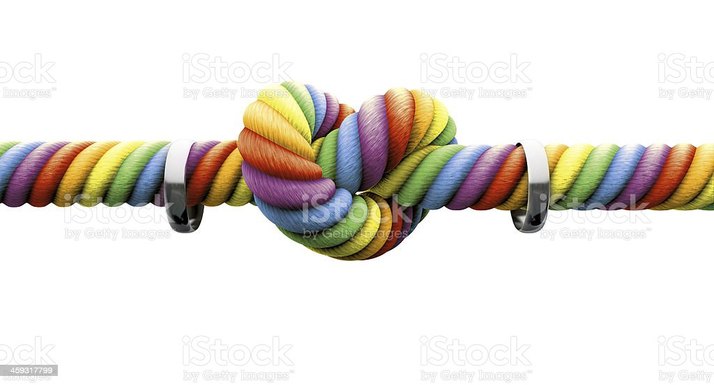 Two wedding rings on rainbow colored rope with knot stock photo