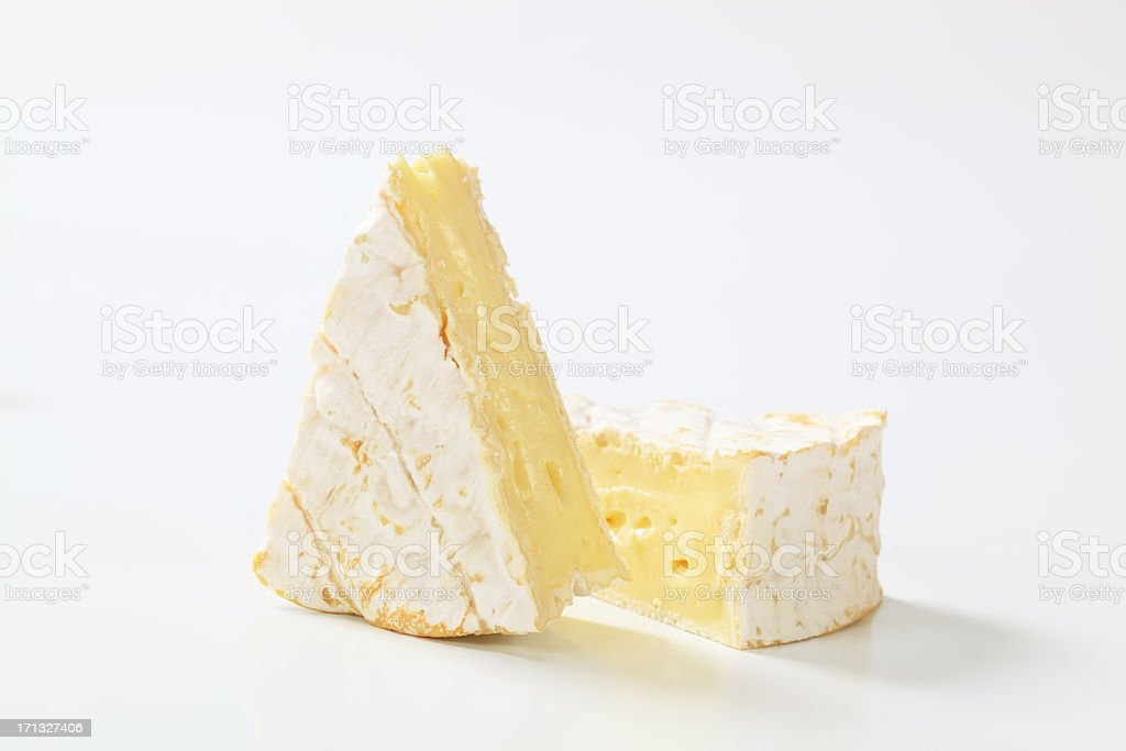 Two wedges of ripe Camembert cheese stock photo